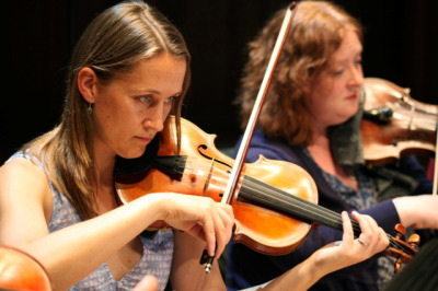 Gabrielle Painter and Louise Bevan playing violins